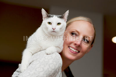 White Cat On Shoulder Facing Camera