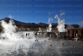 Tourists relaxing in thermal baths at El Tatio geyser field, Region II, Chile