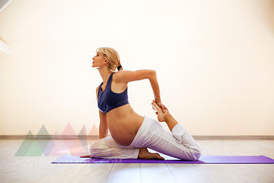 Prenatal yoga, woman doing one-legged king pidgeon pose