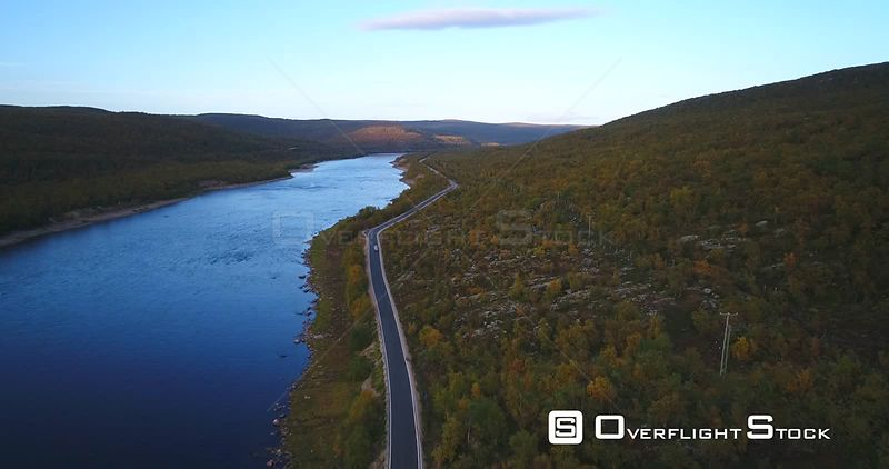 Autumn Color Road, Aerial View Following a Car on 970 the Tenontie Road Full of Different Colors, Near Tenojoki River, on a Sunny Evening Dawn, in Lapland, Finland