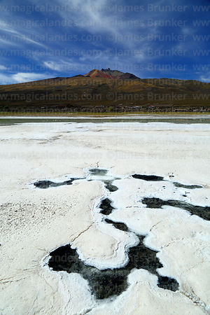 Salt formations, small saline pools and Tunupa volcano, Salar de Uyuni, Bolivia