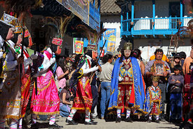 Festival patron carrying figure of Virgen del Carmen with his Kapac Chunchu dance troupe , Paucartambo , Peru