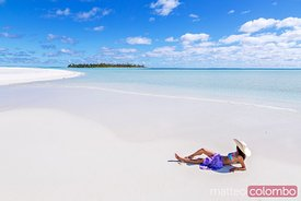Beautiful woman on tropical beach Honeymoon Island, Aitutaki, Cook Islands