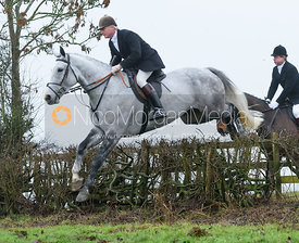 Nick Wright jumping a hedge above Withcote