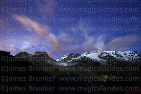 Milky Way setting as rising moon lights up Mt Huayna Potosí, Cordillera Real, Bolivia