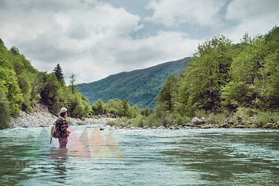 Slovenia, man fly fishing in Soca river