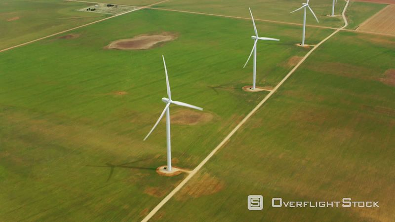 Aerial view of wind turbines in agricultural fields