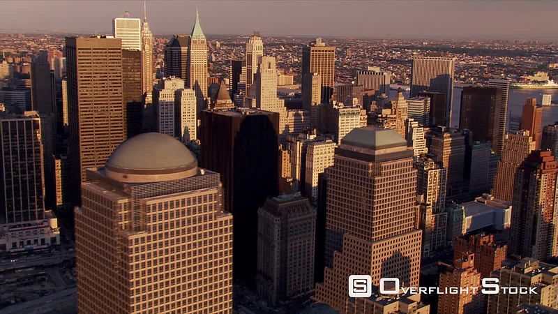 Flying over Manhattan's financial District in afternoon sunshine.