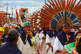 Machetero dancers with figure of San Ignacio during main procession of festival, San Ignacio de Moxos, Bolivia