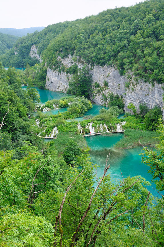 Overview of the lower lakes: Kaluderovac, Gavanovac and Milanovac, limestone cliffs and heavily forested surroundings, Plitvice Lakes National Park, Croatia, July 2010.