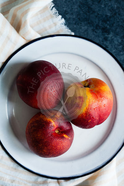 Nectarines on a white plate