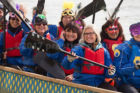 Smiling WOmen Paddling Canoe in the Venice Carnival Water Parade  on the Rio di Cannaregio Canal