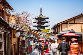 People in the street near pagoda in spring, Kyoto, Japan