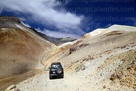Toyota Land Cruiser on mining road on flanks of Acotango volcano, Oruro Department, Bolivia