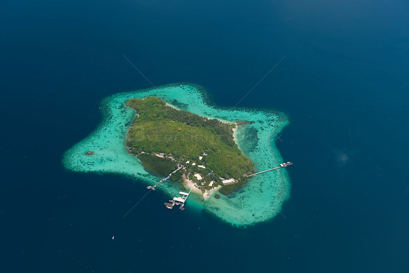 Aerial view of Jewelmer Pearlfarm platform on coral fringed island, Palawan, Philippines, May 2009, cultured Golden South Sea pearls