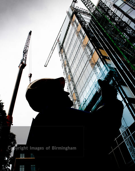 Builder during construction of 11 Brindleyplace, Birmingham, West Midlands,