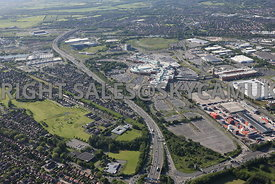 Manchester aerial photograph of Trafford Park and the Intu Trafford Centre looking from across the M 60 motorway and Junction 9 Trafford Park Estate towards junction 10 and the Barton Bridge crossing the Manchester Ship Canal in the distance