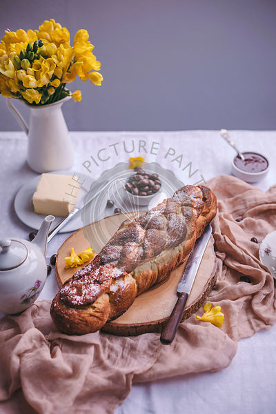 Braided sweet Easter bread served for breakfast with butter and jam