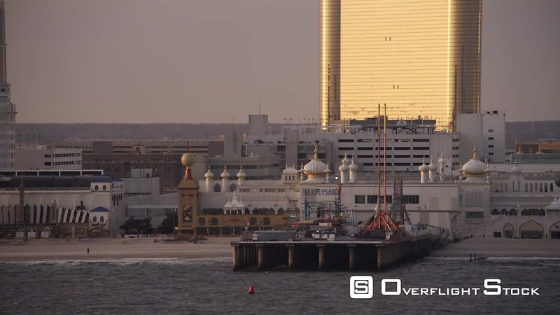 Flying past pier and amusement park in front of Trump Taj Mahal resort in Atlantic City, New Jersey. Shot in November