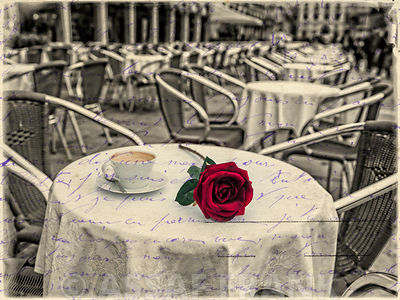 Red rose with a cup of coffee on cafe table, Venice, Italy