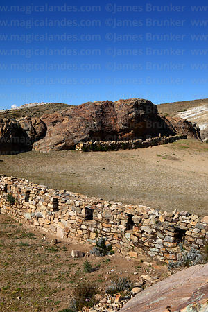 Inca wall and Sacred Rock / Titikala in Sanctuary area near Chincana ruins, Sun Island, Lake Titicaca, Bolivia
