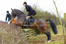 Capt. Max Chenery jumps a hedge away from the meet at Ladywood Lodge