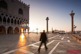 Man walking near Doges palace, Venice, Italy