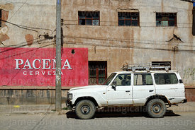 J60 Series Toyota Land Cruiser and Paceña beer mural on wall of building, Uyuni, Bolivia