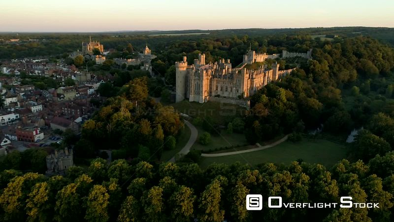 Drone flies slowly through a misty sunrise towards Arundel Castle in West Sussex