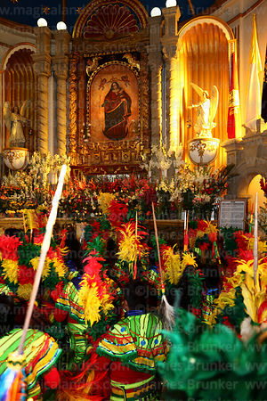 Tobas dance group paying homage to figure of Virgen del Socavón inside Sanctuary, Oruro Carnival, Bolivia