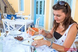 Woman eating a typical greek meal. Kefalonia, Greek Islands, Greece