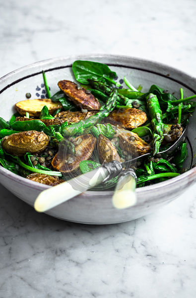 Roasted potato asparagus salad with lentils and spinach.