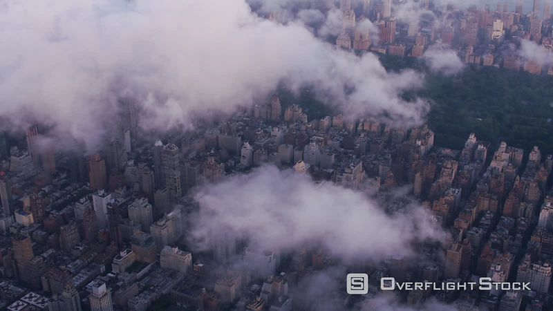 New York City Aerial view of Manhattan with low clouds at sunrise.  Shot with Cineflex and RED EpicW Helium.