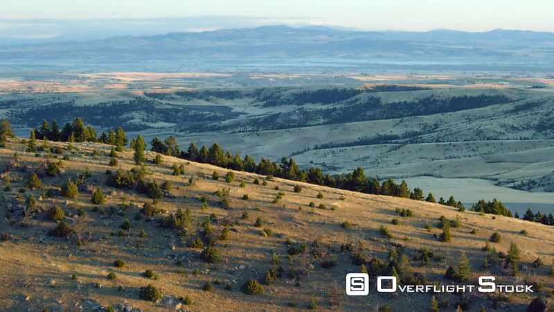 The early morning sunrise highlights the rolling hills in the Gallatin Valley near Bozeman, Montana