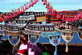 Woollen hats (called chullus or chullos) for sale on stall, Taquile Island , Peru