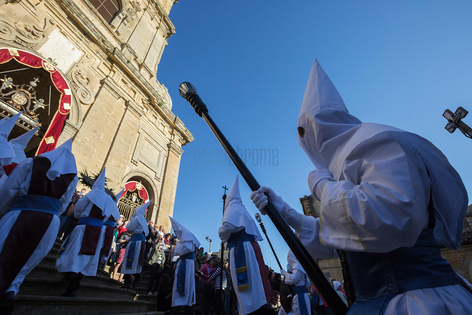 Members of the Confraternita of the Holy Cricifix of Pergusa Climb the Steps of the Cathedral during the Good Friday Procession