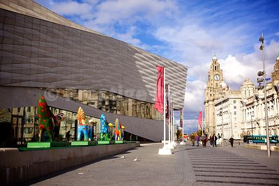 Frontage of the Museum of Liverpool with 4 superlambbanana and the Three Graces Behind
