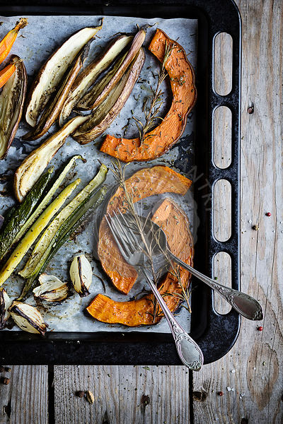 Roasted fresh vegetables on baking sheet. Top view