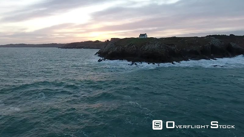 Aerial view of Le Milliier lighthouse in Cap Sizun, filmed by drone, at sunrise, Brittany, Cap Sizun, France