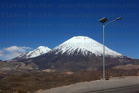 Solar powered street light on Highway 11 , Payachatas volcanos in background , Lauca National Park , Region XV , Chile
