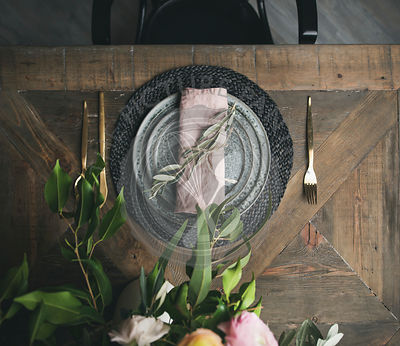Flat-lay of Spring Easter Table setting over vintage wooden background