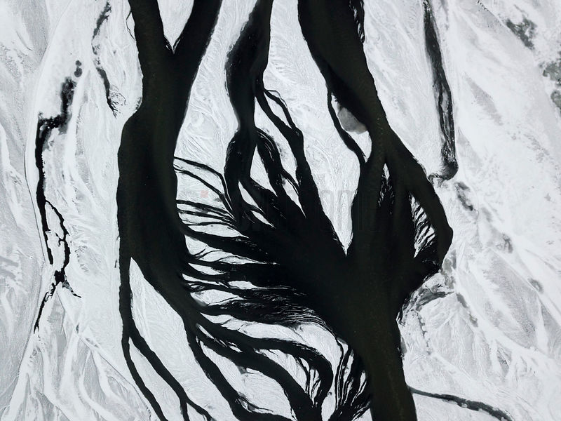 Elevated View of a Braided River Covered with Snow