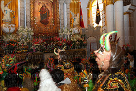China Supay female devil diablada dancers paying homage to figure of Virgen del Socavón inside Sanctuary, Oruro Carnival, Bolivia