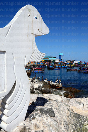 Sea lion monument, fishing port in background, Ilo, Peru