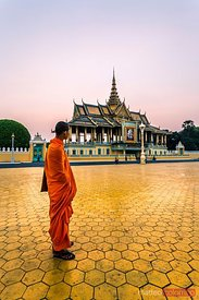 Buddhist monk looking at Royal Palace, Phnom Pehn, Cambodia