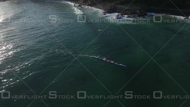 Outrigger Pushing For a Wave Noosa Australia