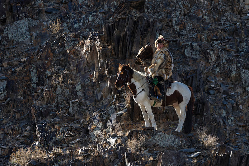 Eagle Hunter On Horseback on a Cliff