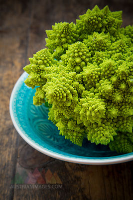 Bowl with Romanesco, Brassica oleracea convar. botrytis var. botrytis, on dark wood