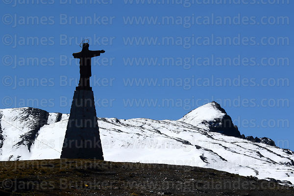 Christ statue and winter snowfall, La Cumbre, Cordillera Real, Bolivia