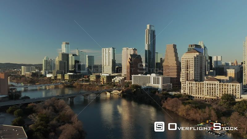 Lady Bird Lake with view of cityscape buildings in downtown Austin, Texas.